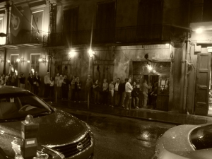 People queuing for the show at Preservation Hall in the rain